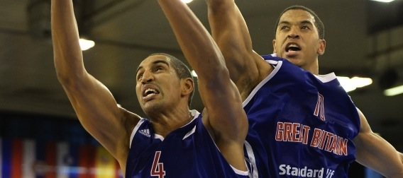 KieronAchara and MylesHessonjumpforpossessionintheStandardLifeGBMensvictoryoverIsraelatEuroBasket2013.JPG_low