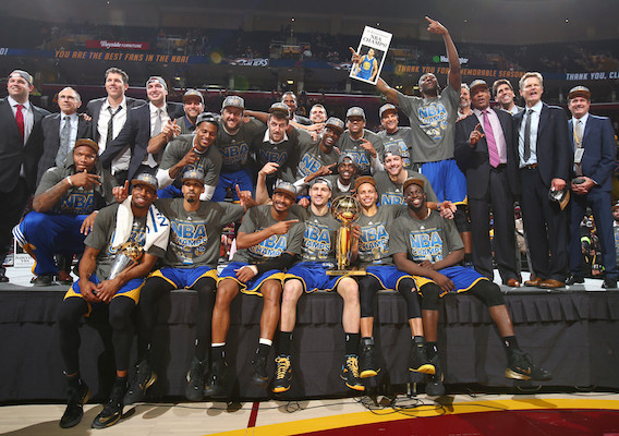 CLEVELAND, OH - JUNE 16:  The Golden State Warriors smile while hugging the Larry O'Brien Championship Trophy after the Golden State Warriors win Game Six of the 2015 NBA Finals at The Quicken Loans Arena on June 16, 2015 in Cleveland, Ohio. NOTE TO USER: User expressly acknowledges and agrees that, by downloading and/or using this Photograph, user is consenting to the terms and conditions of the Getty Images License Agreement. Mandatory Copyright Notice: Copyright 2015 NBAE (Photo by Nathaniel S. Butler/NBAE via Getty Images)