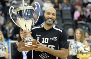 BIRMINGHAM - JANUARY 17: Charles Smith #10 of the Newcastle Eagles with the BBL Cup during the 2016 BBL Cup final between the Newcastle Eagles and Leicester Riders  on January 17th, 2016 at the Barclaycard Arena, Birmingham. Mandatory Copyright Notice: Copyright 2016 Ahmedphotos. Photo by Mansoor Ahmed/Ahmedphotos.