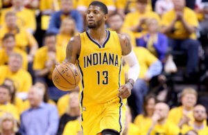 INDIANAPOLIS, IN - APRIL 21:  Paul George #13 of the Indiana Pacers dribbles the ball against the Toronto Raptors during game three of the 2016 NBA Eastern Conference Quarterfinal Playoffs at Bankers Life Fieldhouse on April 21, 2016 in Indianapolis, Indiana.   NOTE TO USER: User expressly acknowledges and agrees that, by downloading and or using this photograph, User is consenting to the terms and conditions of the Getty Images License Agreement.  (Photo by Andy Lyons/Getty Images)